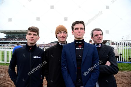 AINTREE. Last year's GRAND NATIONAL winning jockey, DAVID MULLINS (cap) watching The Betway Bowl Chase with (L-R) Jamie Bargery, Danny Mullins and Alain Cawley.
