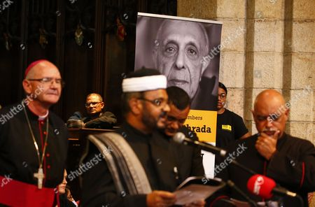 An image of Ahmed Kathrada is shown behind South African religeous leaders during the memorial service for Ahmed Kathrada in Cape Town, South Africa, 06 April 2017. Kathrada, an anti-apartheid struggle icon and close friend of the late former South African President, Nelson Mandela died on 28 March.  Former Finance Minister Pravin Gordhan was given a standing ovation as various speakers at the service slated President Zuma amidst a growing backlash against his recent government reshuffle and axing of the finance minister.