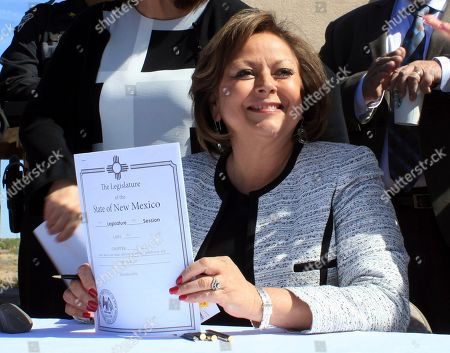 Stock Image of Susanna Martinez New Mexico Gov. Susana Martinez holds signed legislation that expands access to the overdose antidote naloxone during a ceremony at a substance abuse treatment center for youth in Albuquerque, N.M., on . With the signing, New Mexico becomes the first state to require all state and local law enforcement officers to be equipped with naloxone. The measure also requires treatment clinics to educate their patients and provide two doses of naloxone and a prescription for the overdose-reversal drug