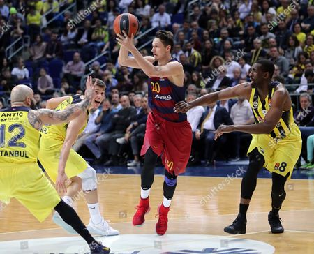 Marcus Eriksson (2nd R) of Barcelona Lassa in action against Fenerbahce's Pero Antic (L), Bogdan Bogdanovic (2nd L) and Ekpe Udoh (R) during the Euroleague basketball match between Fenerbahce Istanbul and Barcelona Lassa in Istanbul, Turkey, 06 April 2017.