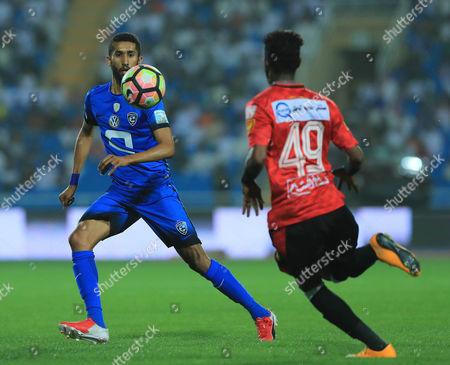 Al-Hilal player Salman Al-Faraj (L) in action for the ball with Al-Raed player Sultan Al-Sawadi (R) during the Saudi Arabia Professional League soccer match between Al-Raed and Al-Hilal at King Abdullah Sport City Stadium, Buraidah, Saudi Arabia, 06 April 2017.