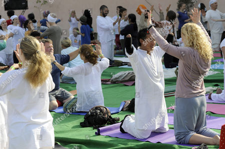 Gurmukh Kaur Khalsa leads a morning class in Kundalini Yoga on the banks of the Ganges