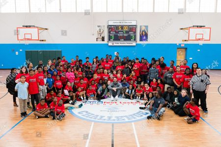 Cavaliers forward Kevin Love, center, poses with Kids Foot Locker stripers and Club kids after presenting a $10,000 check to the Boys & Girls Clubs of Cleveland on behalf of Kids Foot Locker Foundation for completing the Kids Foot Locker Fitness Challenge, in Cleveland