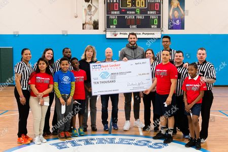 Cavaliers forward Kevin Love, center, poses with Kids Foot Locker stripers and Club kids as he presents a $10,000 check to the Boys & Girls Clubs of Cleveland on behalf of Kids Foot Locker Foundation for completing the Kids Foot Locker Fitness Challenge, in Cleveland