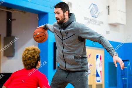 Cavaliers forward Kevin Love, right, runs a dribbling drill with a Club kid after presenting a $10,000 check to the Boys & Girls Clubs of Cleveland on behalf of Kids Foot Locker Foundation for completing the Kids Foot Locker Fitness Challenge, in Cleveland
