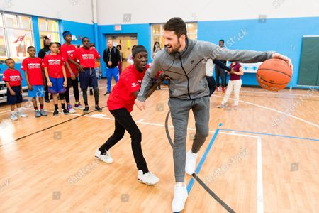 Kevin Love, Rami Bizo Rami Bizo, left, guards Cavaliers forward Kevin Love, right, during a dribbling drill after Love presented a $10,000 check to the Boys & Girls Clubs of Cleveland on behalf of Kids Foot Locker Foundation for completing the Kids Foot Locker Fitness Challenge, in Cleveland