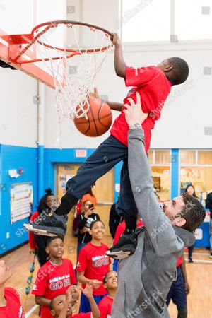 Kevin Love, James Tarver Cavaliers forward Kevin Love, right, lifts James Tarver, left, up for a dunk after presenting a $10,000 check to the Boys & Girls Clubs of Cleveland on behalf of Kids Foot Locker Foundation for completing the Kids Foot Locker Fitness Challenge, in Cleveland