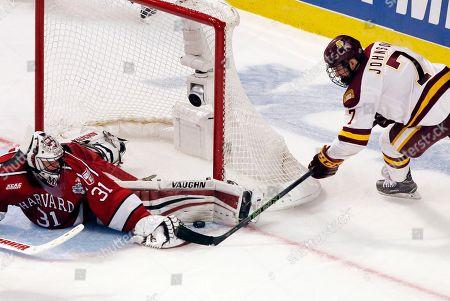 Merrick Madsen, Adam Johnson Harvard goalie Merrick Madsen, left, blocks a shot by Minnesota-Duluth center Adam Johnson during the third period of the NCAA Frozen Four men's college hockey semifinal, in Chicago. Minnesota-Duluth won 2-1