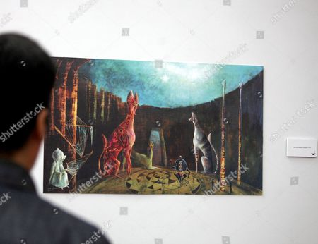 A person views a painting during the opening of the exhibition '100 years of an artist: Leonora Carrington' at Library of Mexico in Mexico City, Mexico, 06 April 2017.