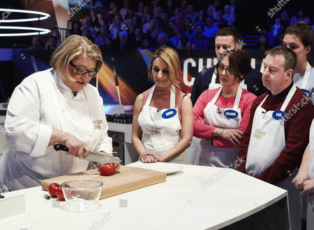 Rosemary Shrager demonstrates her cutting skills to the Amateur cooks
