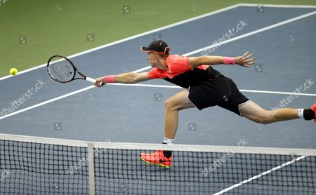 Ilya Ivashka of Belarus in action against Juergen Melzer of Austria during the second round of Davis Cup World Group between Belarus and Austria in Minsk, Belarus, 07 April 2017.