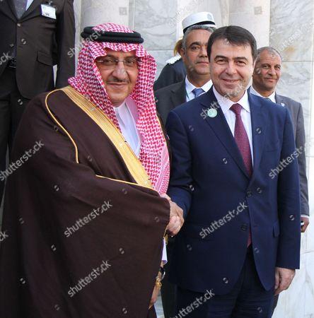 Saudi Arabian Crown Prince and Interior Minister Muhammad bin Nayef (L) sheaks hands with Tunisian Interior Minister Hedi Majdoub