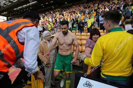 Russell Martin of Norwich City goes into the crowd to give his shirt to the family of Norwich City employee, Peter Oldfield who recently passed - Norwich City v Reading, Sky Bet Championship, Carrow Road, Norwich - 8th April 2017.