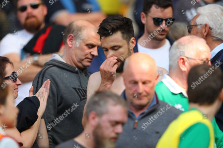 Stock Image of Russell Martin of Norwich City goes into the crowd to give his shirt to the family of Norwich City employee, Peter Oldfield who recently passed - Norwich City v Reading, Sky Bet Championship, Carrow Road, Norwich - 8th April 2017.