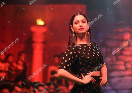 "Indian actress Tamannaah Bhatia walks the ramp in a fashion show organized to promote the movie ""Baahubali 2: The Conclusion"" in Mumbai, India"