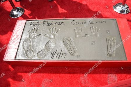 Stock Picture of Carl Reiner and Rob Reiner hand and footprints