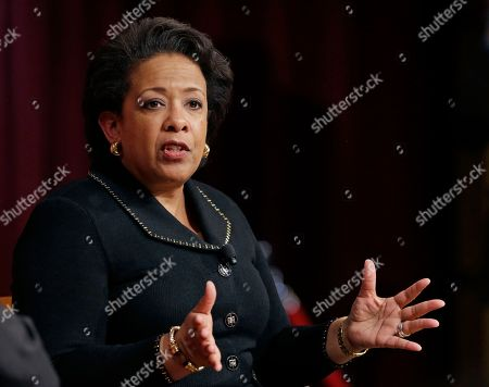Former U.S. Attorney General Loretta Lynch, the nation's first black woman to head the Justice Department, speaks during a conference on policy and blacks at Harvard University's Kennedy School of Government, in Cambridge, Mass. The 57-year-old North Carolina native graduated from Harvard College in 1981 and from Harvard Law School in 1984
