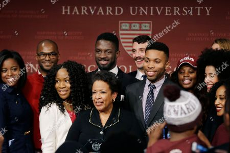 Former U.S. Attorney General Loretta Lynch, bottom center, the nation's first black woman to head the Justice Department, poses with students after speaking at a conference on policy and blacks at Harvard University's Kennedy School of Government, in Cambridge, Mass. The 57-year-old North Carolina native graduated from Harvard College in 1981 and from Harvard Law School in 1984