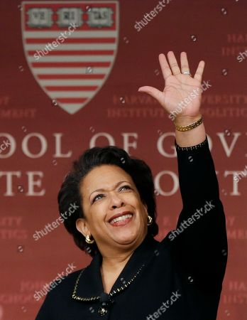 Former U.S. Attorney General Loretta Lynch, the nation's first black woman to head the Justice Department, waves as she arrives to speak at a conference on policy and blacks at Harvard University's Kennedy School of Government, in Cambridge, Mass. The 57-year-old North Carolina native graduated from Harvard College in 1981 and from Harvard Law School in 1984