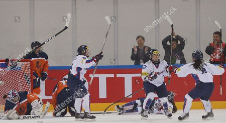 Han Soo-jin, Lee Eun-ji, Eom Su-yeon South Korea's Han Soo-jin, second from right, celebrates with her teammates Lee Eun-ji and Eom Su-yeon, right, after scoring a goal against the Netherlands during their IIHF Ice Hockey Women's World Championship Division II Group A game in Gangneung, South Korea