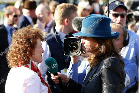 One for Arthur trainer Lucinda Russell is interviewed by itv racing correspondent Alice Plunkett after victory in the Grand National during day three of the Randox Health Grand National festival held at Aintree, Liverpool on 8th April, 2017