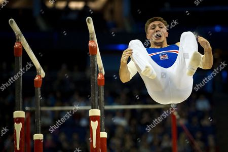 Sam Oldham of Great Britain (GBR) dismounts from the Parallel bars during the iPro Sport World Cup of Gymnastics 2017 at the O2 Arena, London