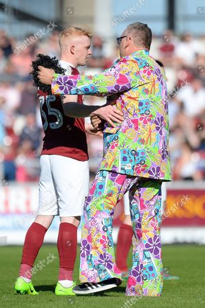 A Sheffield United fan confronts Northampton Town striker (on loan from Scunthorpe United) Luke Williams (35) on the pitch during the EFL Sky Bet League 1 match between Northampton Town and Sheffield Utd at Sixfields Stadium, Northampton