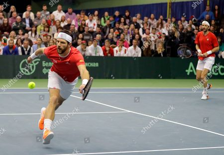 Julian Knowle, Jurgen Melzer Austria's Jurgen Melzer, left, returns a ball as partner Julian Knowle follows play during their Davis Cup Euro-African Zone First Group, second round, tennis match against Yaraslav Shyla and Max Mirnyi of Belarus in Minsk, Belarus