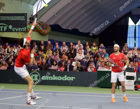 Julian Knowle, Jurgen Melzer Austria's Julian Knowle, left, returns a ball as partner Jurgen Melzer follows play during their Davis Cup Euro-African Zone First Group, second round, tennis match against Yaraslav Shyla and Max Mirnyi of Belarus in Minsk, Belarus