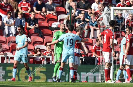 Stock Image of Goalkeeper Victor Valdes of Middlesbrough clashes with Joey Barton of Burnley during  the Premier League match between Middlesbrough and Burnley played at The Riverside Stadium,  Middlesbrough on Saturday the 8th of April 2017