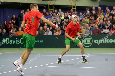Max Mirnyi, Yaraslav Shyla Belarus' Max Mirnyi, left, returns a ball as partner Yaraslav Shyla follows play during their Davis Cup Euro-African Zone First Group, second round, tennis match against Julian Knowle and Jurgen Melzer of Austria in Minsk, Belarus