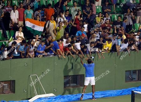 India's Rohan Bopanna greets fans after winning the doubles match with compatriot Sriram Balaji against Uzbekistan's Farrukh Dustov and Sanjar Fayziev during their Davis Cup tennis Asia-Oceania second round tie between India and Uzbekistan, in Bangalore, India