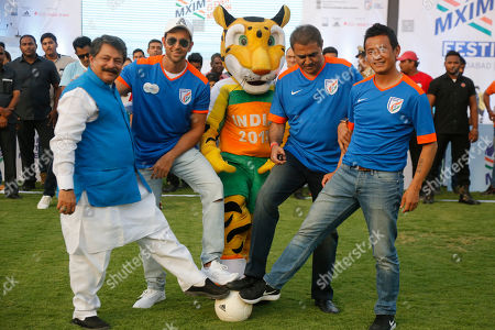 Bollywood actors Hrithik Roshan, second left, Former Indian football captain Bhaichung Bhutia, right, and All India Football Federation(AIFF) president Praful Patel, second right, pose for photographs during Mission XI Million mega football festival in Ahmadabad, India, . Mission XI Million aims in getting 11 million children in contact with the game of football, leading up to the FIFA U-17 World Cup which will be held in India in 2017
