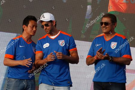 Bollywood actors Hrithik Roshan, center, listens to former Indian football captain Bhaichung Bhutia, as All India Football Federation (AIFF) president Praful Patel stands beside them during Mission XI Million mega football festival in Ahmadabad, India, . Mission XI Million aims in getting 11 million children in contact with the game of football, leading up to the FIFA U-17 World Cup which will be held in India in 2017