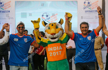 Bollywood actors Hrithik Roshan, left, and All India Football Federation (AIFF) president Praful Patel pose for photograph with Khaleo the clouded leopard, the mascot for FIFA U-17, during Mission XI Million mega football festival in Ahmadabad, India, . Mission XI Million aims in getting 11 million children in contact with the game of football, leading up to the FIFA U-17 World Cup which will be held in India in 2017
