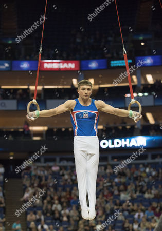 Stock Image of Sam Oldham (GBR) in action during the menÕs Rings competition.  FIG World Cup Series of Gymnastics. The O2 Arena, London,  Britain 8th April 2017.