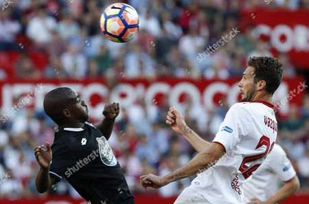 Sevilla FC's Argentinian midfielder Franco Vazquez (R) fights for the ball with Deportivo La Coruna´s French midfielder Gael Kakuta (L) during the Primera Division soccer match between Sevilla FC and Deportivo La Coruna played at Ramon Sanchez-Pizjuan in Seville, Andalusia, Spain on 08 April 2017.