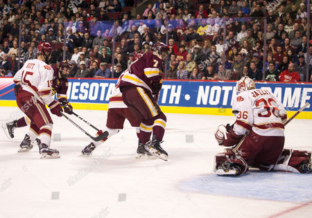 Denver goaltender Tanner Jaillet (36) makes the save on shot by Minnesota Duluth forward Adam Johnson (7) during NCAA Hockey Frozen Four Championship game action between the Minnesota-Duluth Bulldogs and the Denver Pioneers at United Center in Chicago, Illinois. Denver defeated Minnesota-Duluth 3-2