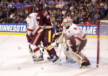 Minnesota Duluth forward Adam Johnson (7) sets screen in front of Denver goaltender Tanner Jaillet (36) during NCAA Hockey Frozen Four Championship game action between the Minnesota-Duluth Bulldogs and the Denver Pioneers at United Center in Chicago, Illinois. Denver defeated Minnesota-Duluth 3-2