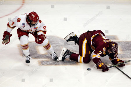 Adam Johnson, Tyson McLellan Minnesota-Duluth center Adam Johnson, right, controls the puck against Denver left wing Tyson McLellan during the first period of an NCAA Frozen Four championship college hockey game, in Chicago