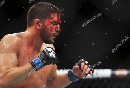 Patrick Cote pauses during a welterweight mixed martial arts bout at UFC 210 against Thiago Alves, in Buffalo, N.Y