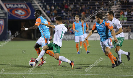 New York Cosmos midfielder Andres Alexander Flores Mejia (11) battles for the ball with Miami FC midfielder Kwadwo Poku (10) during a North American Soccer League game between the New York Cosmos vs Miami FC at the Riccardo Silva Stadium in Miami, Florida. New York Cosmos won 2-0