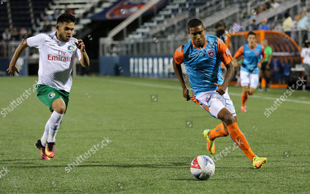 Miami FC forward Stefano Pinho (29) moves the ball past New York Cosmos midfielder Andres Alexander Flores Mejia (11) during a North American Soccer League game between the New York Cosmos vs Miami FC at the Riccardo Silva Stadium in Miami, Florida