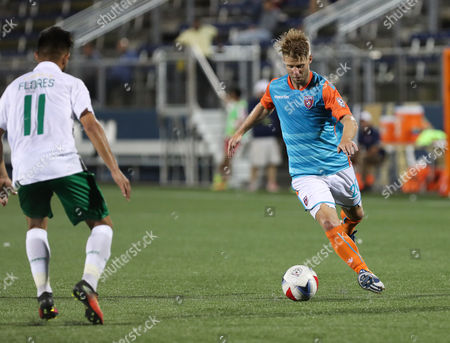 Miami FC midfielder Richie Ryan (20) moves the ball challenged by New York Cosmos midfielder Andres Alexander Flores Mejia (11) during a North American Soccer League game between the New York Cosmos vs Miami FC at the Riccardo Silva Stadium in Miami, Florida. New York Cosmos won 2-0