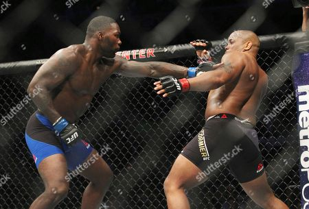 Daniel Cormier, right, tries to avoid a punch from Anthony Johnson during a light heavyweight mixed martial arts bout at UFC 210, early, in Buffalo, N.Y