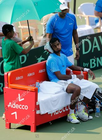 Mahesh Bhupathi, Ramkumar Ramanathan Indian team captain Mahesh Bhupathi, standing right, helps teammate Ramkumar Ramanathan with an ice pack at the singles match against Uzbekistan's Sanjar Faiziev during their Davis Cup tennis Group I, Asia-Oceania second round tie between India and Uzbekistan, in Bangalore, India, . Ramanathan won the match 6-3, 6-2