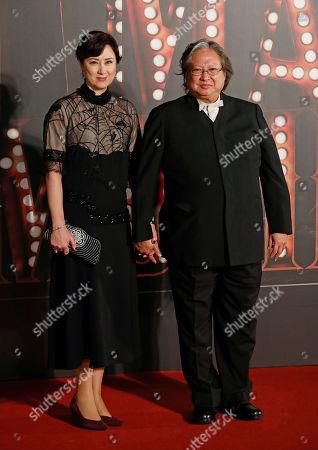 Sammo Hung, Joyce Mina Godenzi Hong Kong director Sammo Hung, right, and his wife Joyce Mina Godenzi pose on the red carpet of the Hong Kong Film Awards in Hong Kong