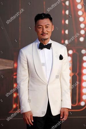 Hong Kong actor Shawn Yue poses on the red carpet of the Hong Kong Film Awards in Hong Kong