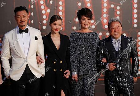 Shawn Yue, Charmaine Fong, Elaine Jin, Eric Tsang From left, Hong Kong actor Shawn Yue, actress Charmaine Fong, Taiwanese actress Elaine Jin and Hong Kong actor Eric Tsang pose on the red carpet of the Hong Kong Film Awards in Hong Kong