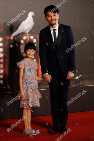 Gordon Lam, Aoi Ma Hong Kong actor Gordon Lam, right, and actress Aoi Ma pose on the red carpet of the Hong Kong Film Awards in Hong Kong